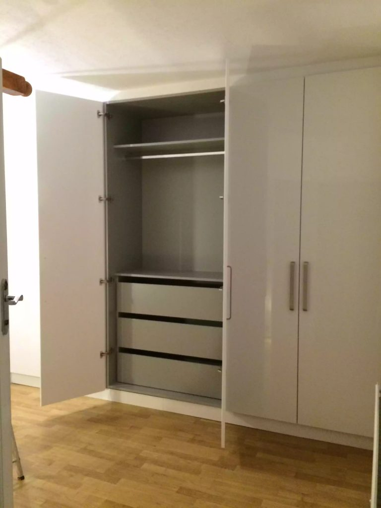 custom-fitted white acrylic wardrobe