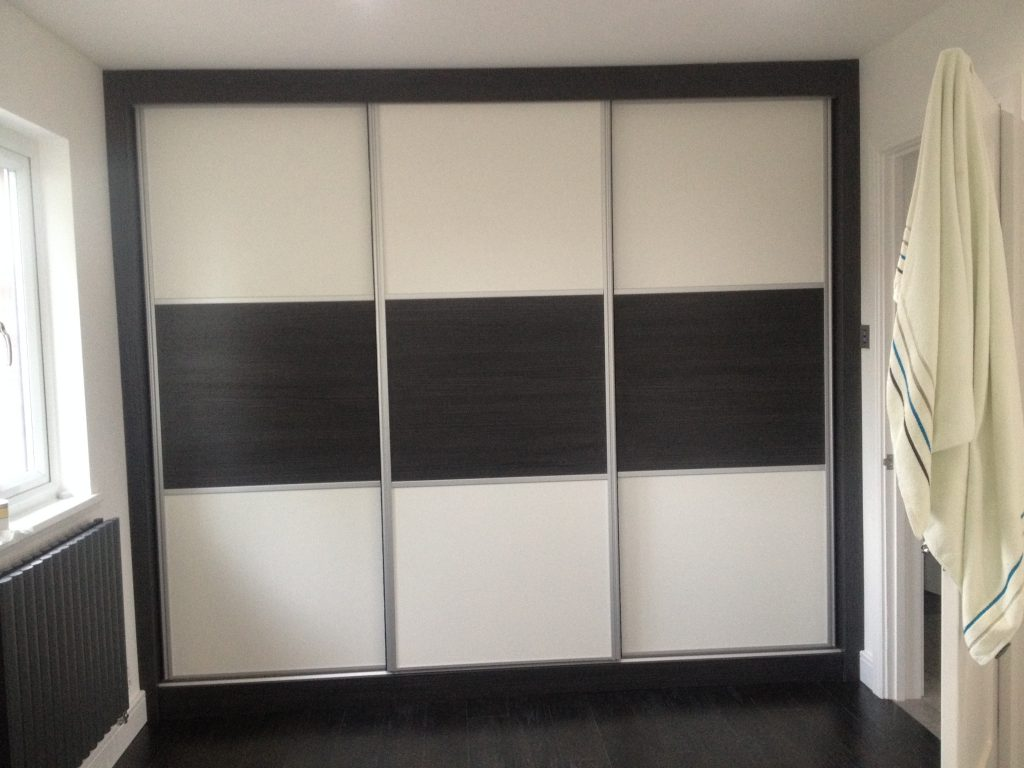 Dark wood and ivory sliding door wardrobe