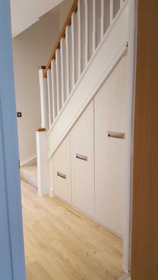 Under-stairs pull-out cabinet