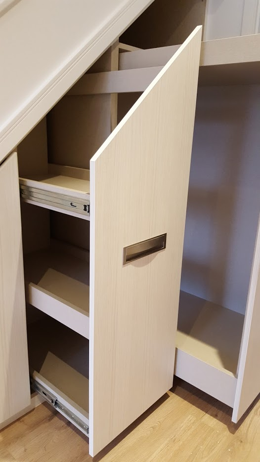 Concealed under-stairs cabinets