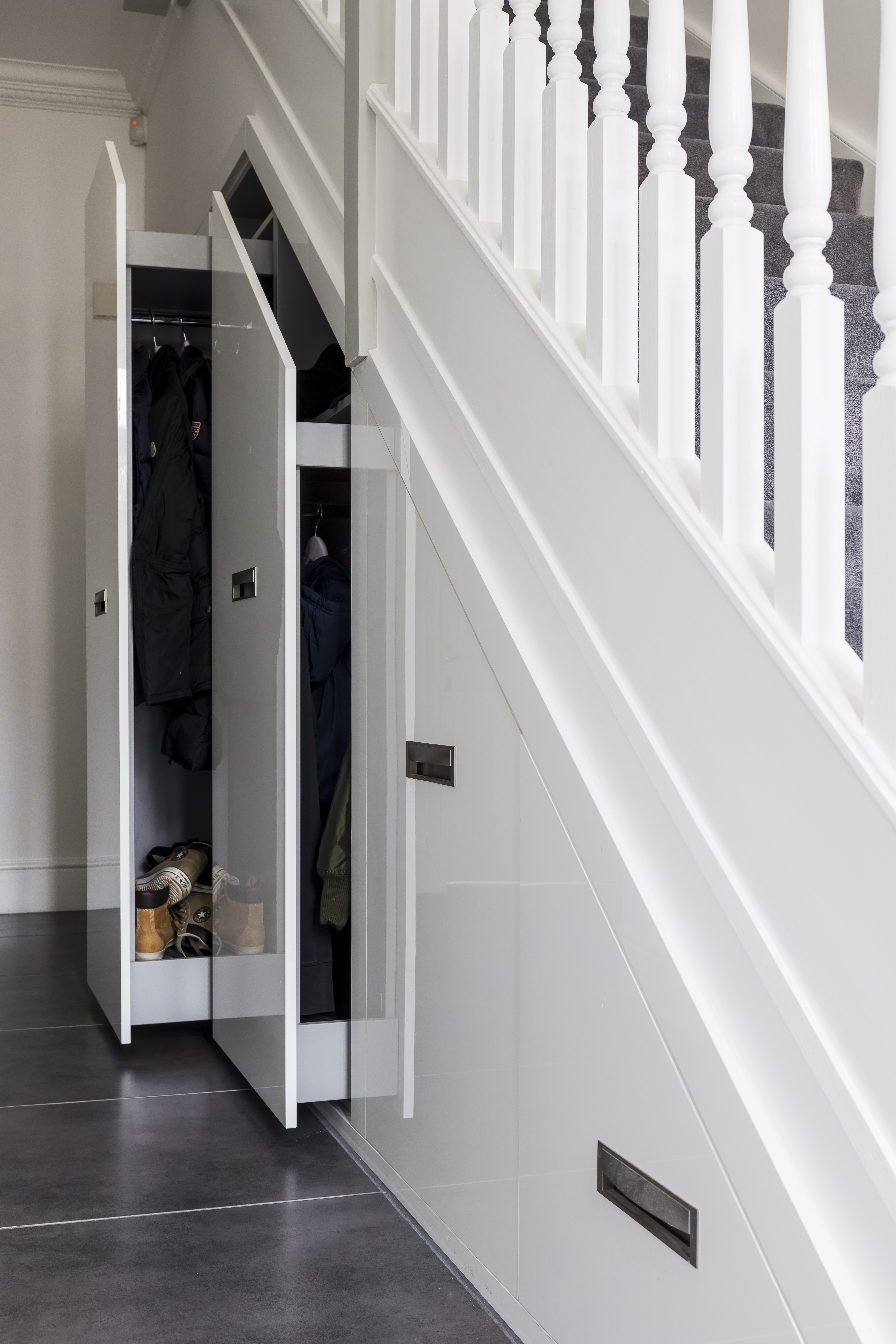 White pull-out under-stairs cabinets
