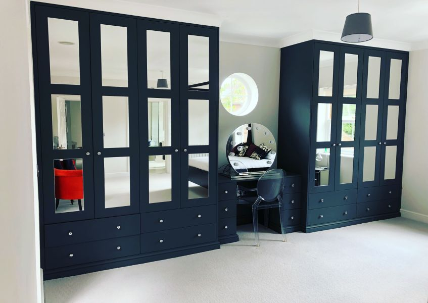 Mirrored paneled fitted wardrobe